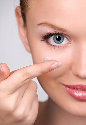 Woman holding contact lens - eye exam - optometrist - Chula Vista, CA